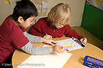 Education Elementary School Grade 2 science social studies project two boys working together horizontal