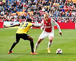 Nederland, Amsterdam, 19 april 2015<br /> Eredivisie<br /> Seizoen 2014-2015<br /> Ajax-NAC Breda (0-0)<br /> Viktor Fischer van Ajax en Divine Naah van NAC strijden om de bal