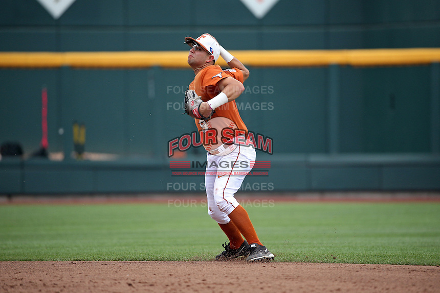 C.J Hinojosa #9 of the Texas Longhorns throws during Game 1 of the 2014 Men's College World Series between the UC Irvine Anteaters and Texas Longhorns at TD Ameritrade Park on June 14, 2014 in Omaha, Nebraska. (Brace Hemmelgarn/Four Seam Images)