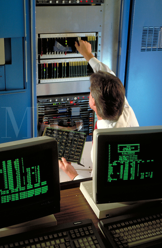 Male computer Technician replacing Circuit Board, computers, occupations, electronics.
