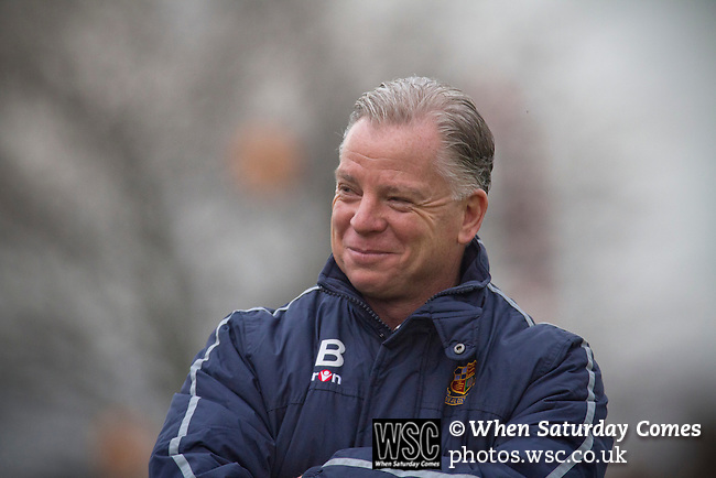 Wealdstone 0 Newport County 0, 17/03/2012. St Georges Stadium, FA Trophy Semi Final. Home manager Gordon Bartlett smiling at St Georges Stadium, home ground of Wealdstone FC, as the club played host to Newport County (yellow) in the semi-final second leg of the F.A. Trophy. The game ended in a goalless draw, watched by a capacity crowd of 2,092 which meant the visitors from Wales progressed by three goals to one to the competition's final at Wembley, where they would meet York City. The F.A. Trophy was the premier cup competition for non-League clubs in England and Wales affiliated to the Football Association. Photo by Colin McPherson.