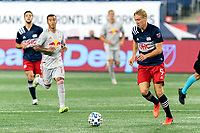 FOXBOROUGH, MA - AUGUST 29: Adam Buksa #9 of New England Revolution dribbles during a game between New York Red Bulls and New England Revolution at Gillette Stadium on August 29, 2020 in Foxborough, Massachusetts.
