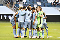 KANSAS CITY, KS - OCTOBER 11: Sporting KC players in a huddle during a game between Nashville SC and Sporting Kansas City at Children's Mercy Park on October 11, 2020 in Kansas City, Kansas.