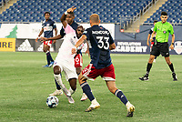 FOXBOROUGH, MA - SEPTEMBER 04: Don Smart #7 Forward Madison FC stretches to pass the ball with Maciel #6 of New England Revolution II and Tiago Mendonca #33 of New England Revolution II closing in during a game between Forward Madison FC and New England Revolution II at Gillette Stadium on September 04, 2020 in Foxborough, Massachusetts.