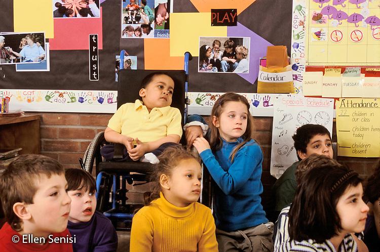 MR / Schenectady, NY.Zoller Public School / Grade 1 Inclusion Class.Students listen to teacher. (Boy in wheelchair: 7, spina bifida, sacral agenesis, Bangledeshi & Puerto-Rican American)..MR: SNB.PN#:30056                       FC#:21651-01005.scan from slide.©Ellen B. Senisi
