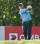 Yih-Shin Chan tees off at the third hole on Round 2 of the CIMB Asia Pacific Classic 2011.  Photo © Andy Jones / PSI for Carbon Worldwide