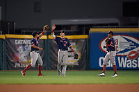 Portland Sea Dogs outfielders Luke Tendler (10), Jarren Duran (18), and Deiner Lopez (33) celebrate closing out an Eastern League game against the Erie SeaWolves on June 17, 2019 at UPMC Park in Erie, Pennsylvania.  Portland defeated Erie 6-3.  (Mike Janes/Four Seam Images)