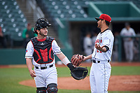 Lansing Lugnuts catcher Ryan Gold (22) talks to Cobi Johnson (21) during a Midwest League game against the Wisconsin Timber Rattlers at Cooley Law School Stadium on May 1, 2019 in Lansing, Michigan. Wisconsin defeated Lansing 8-3 after the game was suspended from the previous night. (Zachary Lucy/Four Seam Images)