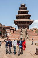 Bhaktapur, Nepal.  Nyatapola Temple, Taumadhi Square, and Nepalese Students.  The temple survived the April 2015 earthquake virtually undamaged.