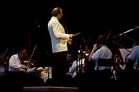 Montreal (Qc) CANADA -  July 1993 File Photo - <br /> Montreal Symphonic Orchestra and its conductor Charles Dutoit perform a free outdoor concert in a parc south of Montreal.
