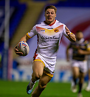 13th November 2020; The Halliwell Jones Stadium, Warrington, Cheshire, England; Betfred Rugby League Playoffs, Catalan Dragons versus Leeds Rhinos; Tom Davies of Catalans Dragons runs in a try