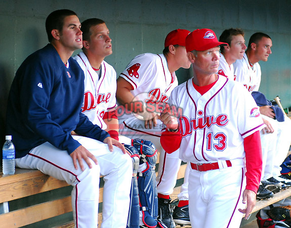 April 28, 2009: Bob Kipper, pitching coach of the Greenville Drive, Class A affiliate of the Boston Red Sox, talks with RHP Casey Kelly, left, and catcher Tim Federowicz, second from right, during a game against the Savannah Sand Gnats at Fluor Field at the West End in Greenville, S.C. Kelly picked up the win. Photo by: Tom Priddy/Four Seam Images