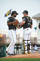 Pittsburgh Pirates first baseman Josh Bell (55) and catcher Reese McGuire (84) during a Spring Training game against the Toronto Blue Jays  on March 3, 2016 at McKechnie Field in Bradenton, Florida.  Toronto defeated Pittsburgh 10-8.  (Mike Janes/Four Seam Images)