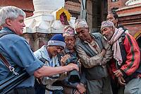 Bhaktapur, Nepal.  Tourist Showing Newari Men their Photo on Camera Screen.