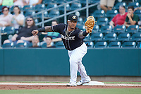Charlotte Knights first baseman Yermin Mercedes (24) stretches for a throw during the game against the Gwinnett Stripers at Truist Field on July 15, 2021 in Charlotte, North Carolina. (Brian Westerholt/Four Seam Images)