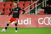 WASHINGTON, DC - MAY 13: Brendan Hines Ike #4 of D.C. United plays the ball during a game between Chicago Fire FC and D.C. United at Audi FIeld on May 13, 2021 in Washington, DC.