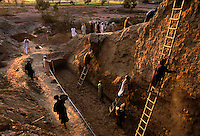 Harappam, an archeology site in the Indus Valley is uncoveed bit and bit as workers carry bowls of dirt away. The scene is not unlike a modern day movie set.<br /> Developments at Harappa have pushed the dates back 200 years for this civilization, proving once and for all, that this civilization was not just an offshoot of Mesopotamia..They were a highly organized and very successful civilization.  They built some of the world's first planned cities, created one of the world's first written languages and thrived in an area twice as large as Egypt or Mesopotamia for 900 years (1500 settlements spread over 280,000 square miles on the subcontinent)..There are three major communities--Harappa, Mohenjo Daro, and Dholavira. The town of Harappa flourished during this period because of it's location at the convergence of several trade routes that spanned a 1040 KM swath from the northern mountains to the coast.