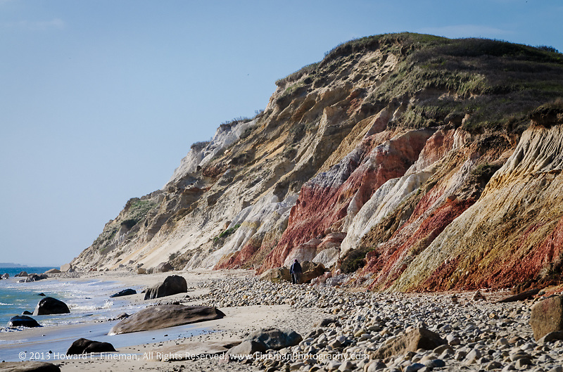 The Gay Head cliffs, seen here from Moshup Beach, show beautifully variegated clay colors despite years of erosion. The two people in the center at the foot of the cliffs give a good sense of the height.