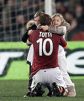 Calcio, Serie A: Roma vs Genoa. Roma, stadio Olimpico, 3 marzo 2013..AS Roma forward Francesco Totti kisses his children Cristian, left, and Chanel, at the end of the Italian Serie A football match between AS Roma and Genoa at Rome's Olympic stadium, 3 March 2013..UPDATE IMAGES PRESS/Riccardo De Luca