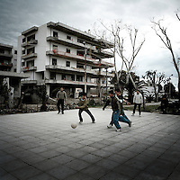 Young Afghan refugees play football next to an abandoned building where they squat. It is located near to the port where they try to hide in trucks or ships to go overseas. Patras is home to about 3,000 illegal immigrants. Most of them are Afghans, although there are also some Iranians and Uzbeks. They stop in Patras to try and find passage to various European destinations by hiding in ships, containers and trucks parked in the port. If they are lucky they will make it to their destination. Many of them live in shacks made from cartons, plastic and wood they found on the beach. To shelter from the cold they also squat in abandoned buildings, living without water and electricity. The living conditions are inhumane and unhygienic.