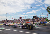 Jun 6, 2015; Englishtown, NJ, USA; NHRA top fuel driver Leah Pritchett (near lane) races alongside Brittany Force during qualifying for the Summernationals at Old Bridge Township Raceway Park. Mandatory Credit: Mark J. Rebilas-