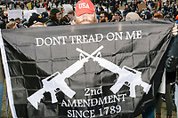 "Pro-gun demonstrators antagonize the much larger crowd surrounding them in Boston Common during the March For Our Lives protest and demonstration in Boston, Massachusetts, USA, on Sat., March 24, 2018, in response to recent school gun violence. Here a man holds a flag reading ""Don't tread on me / 2nd Amendment since 1789."""