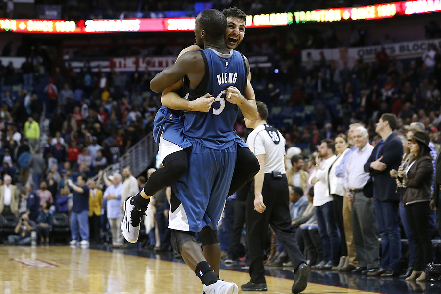 Minnesota Timberwolves guard Ricky Rubio (9) and Minnesota Timberwolves center Gorgui Dieng (5) celebrate after defeating the New Orleans Pelicans 112-110 after an NBA basketball game Saturday, Feb. 27, 2016, in New Orleans. (AP Photo/Jonathan Bachman)