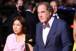 Cannes Film Festival 2021 . 74th edition of the 'Festival International du Film de Cannes' under Covid-19 outbreak on 10/07/2021 in Cannes, France. US director Oliver Stone (R).<br /> © Pierre Teyssot / Maxppp