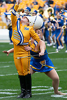 Pitt drum major Crissy Shannon (in yellow) has a baton twirled around her by a Pitt Golden Girl majorette. The Miami Hurricanes football team defeated the Pitt Panthers 16-12 in a game at Heinz Field, Pittsburgh, Pennsylvania on October 26, 2019.