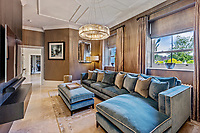 BNPS.co.uk (01202 558833)<br /> Pic: Savills/BNPS<br /> <br /> Pictured: A lounge space.<br /> <br /> A striking turreted French style chateau in one of the UK's most desirable streets is on the market for £9.25m.<br /> <br /> Deauville is an impressive mansion with a striking period exterior but a stylish contemporary look inside and all the mod cons a home owner would want, including an indoor pool complex and cinema room.<br /> <br /> The house is in the prestigious St George's Hill estate in Weybridge, Surrey, which is renowned all over the world.<br /> <br /> The five-bedroom house was built in 2000 but has undergone an extensive refurbishment in the last few years.