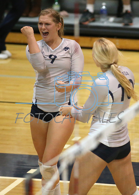 Nevada's Madison Morell (9) and Sam Willouoghby (10) celebrate a point against Air Force during college volleyball action in Reno, Nev., on Thursday, Sept. 25, 2014. Air Force won 3-2.<br /> Photo by Cathleen Allison