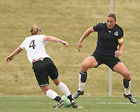 Abby Wambach (blue) of the Washington Freedom defender against Jen Buczkowski of Sky Blue F.C. during a WPS pre season match at Maryland Soccerplex,in Boyd's, Maryland on March 14 2009. Sky Blue won the match 1-0