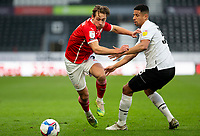 7th November 2020; Pride Park, Derby, East Midlands; English Football League Championship Football, Derby County versus Barnsley; Callum Brittain of Barnsley turns quickly on the ball as he gets away from Curtis Davies of Derby County