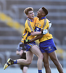 Adam O Connor and Chibby Okoye of Clare celebrate following their Munster Minor football semi-final win against Tipperary at Thurles. Photograph by John Kelly.