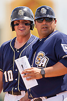 San Antonio Missions designated hitter Hunter Renfroe (10) and manager Rod Barajas (50) during the Texas League baseball game against the Midland RockHounds on June 28, 2015 at Nelson Wolff Stadium in San Antonio, Texas. The Missions defeated the RockHounds 7-2. (Andrew Woolley/Four Seam Images)