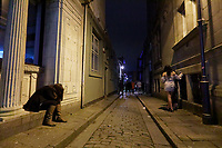 Pictured: A woman rests in a lane in Swansea. Tuesday 31 December 2019 to Wednesday 01 January 2020<br /> Re: Revellers on a night out for New Year's Eve in Wind Street, Swansea, Wales, UK.