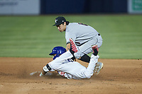 Shay Whitcomb (6) of the Fayetteville Woodpeckers applies a tag to Brandon Bossard (25) of the Kannapolis Cannon Ballers as he tries to stretch a single into a double at Atrium Health Ballpark on June 22, 2021 in Kannapolis, North Carolina. (Brian Westerholt/Four Seam Images)