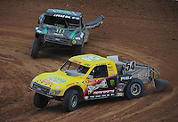 Mar. 20, 2011; Chandler, AZ, USA;  LOORRS pro two driver Rob Naughton (54) leads Jeremy McGrath (2) during round two at Firebird International Raceway. Mandatory Credit: Mark J. Rebilas-