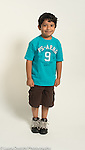Portrait of 6 year old boy, standing, full length, in summer clothing