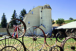 Famous Wagon Wheel Fence and Barn, Palouse Hills, Washington, known as the heart of wheat farming in the United States is also famous for its rolling scenery.  Near Uniontown, Washington.  Palouse Scenic Byway.