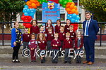 Teacher Colette O'Sullivan and Principal John Burke with their Junior Infants on the first day of school in Fossa NS on Wednesday (names to follow)