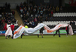 St Mirren 4 The New Saints 1, 19/02/2017. Paisley 2021 Stadium, Scottish Challenge Cup. Groundsmen taking away an advertising sign on the pitch at the Paisley2021 Stadium before Scottish Championship side St Mirren played Welsh champions The New Saints in the semi-final of the Scottish Challenge Cup for the right to meet Dundee United in the final. The competition was expanded for the 2016-17 season to include four clubs from Wales and Northern Ireland as well as Scottish Premier under-20 teams. Despite trailing at half-time, St Mirren won the match 4-1 watched by a crowd of 2044, including 75 away fans. Photo by Colin McPherson.