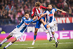 Antoine Griezmann (c) of Atletico de Madrid battles for the ball with Diego Reyees (l) and Javi Fuego of RCD Espanyol during the La Liga match between Atletico de Madrid and RCD Espanyol at the Vicente Calderón Stadium on 03 November 2016 in Madrid, Spain. Photo by Diego Gonzalez Souto / Power Sport Images