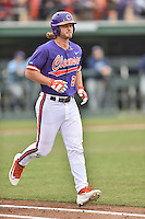 Clemson Tigers left fielder Reed Rohlman (26) runs to first base during a game against the Maine Black Bears at Doug Kingsmore Stadium on February 20, 2016 in Clemson, South Carolina. The Tigers defeated the Black Bears 9-4. (Tony Farlow/Four Seam Images)