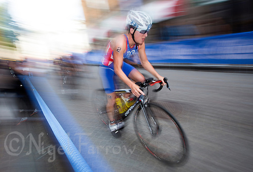 24 AUG 2013 - STOCKHOLM, SWE - Jodie Stimpson (GBR) of Great Britain chases the leaders on the bike during the elite women's ITU 2013 World Triathlon Series round in Gamla Stan in Stockholm, Sweden (PHOTO COPYRIGHT © 2013 NIGEL FARROW, ALL RIGHTS RESERVED)