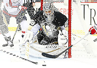 Marc-Andre Fleury #29 of the Pittsburgh Penguins looks for the loose puck through a spray of ice in the third period against the Washington Capitals during the game at Consol Energy Center in Pittsburgh, Pennsylvania on December 14, 2015. (Photo by Jared Wickerham / DKPS)