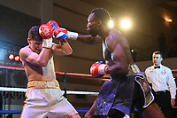 John Harding Jr (R) defeats Kristaps Zulgis during a Boxing Show at the Dunstable Conference Centre on 7th March 2020