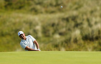 150719 | The 148th Open - Monday Practice<br /> <br /> Jason Day of Australia chips onto the 16th green during practice for the 148th Open Championship at Royal Portrush Golf Club, County Antrim, Northern Ireland. Photo by John Dickson - DICKSONDIGITAL