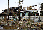 A Cyclone Nargis survivor holds her bicycle as she arrives to a home in the town of Labutta, in Irrawaddy Division, May 10, 2008. Despairing survivors in Myanmar awaited emergency relief on Friday, a week after 100,000 people were feared killed as the cyclone roared across the farms and villages of the low-lying Irrawaddy delta region. The storm is the most devastating one to hit Asia since 1991, when 143,000 people were killed in neighboring Bangladesh. Photo by Eyal Warshavsky  *** Local Caption *** ëì äæëåéåú ùîåøåú ìàéì åøùáñ÷é àéï ìòùåú áúîåðåú ùéîåù ììà àéùåø