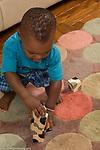 15 month old toddler baby boy playing with blocks vertical stacking blocks